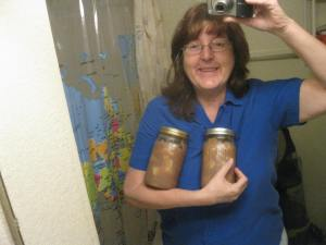 Here's me holding apple pie filling - the first and only 2 jars I've ever made. It was GREAT on a gluten-free cake.