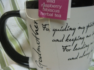 Day 15. 16 ounces of brew fill my Godmother mug. Tea of choice today is by Stash: Wild Hibiscus Herbal Tea..