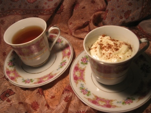 Here I am having a mini  cinnamon cake and tea in matching tea cups.